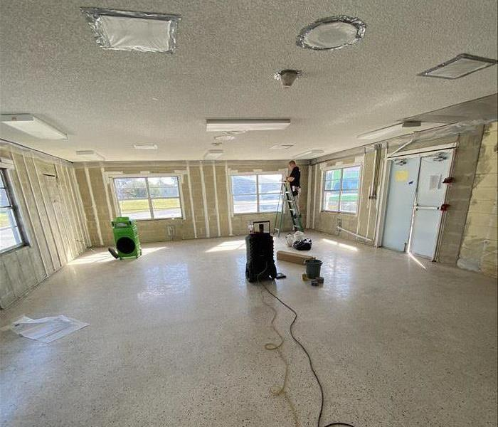 empty room being cleaned by a technician