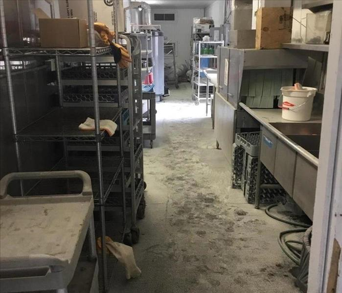 back room of building with racks - dirty