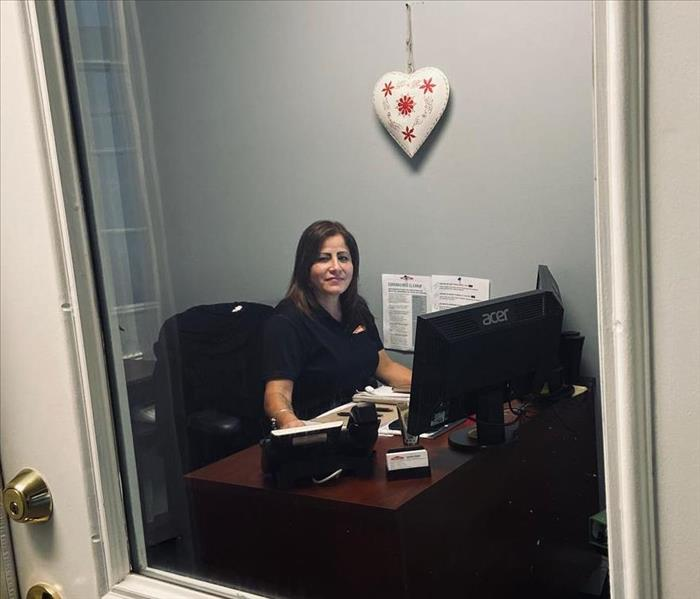 woman sitting at a desk in a closed office